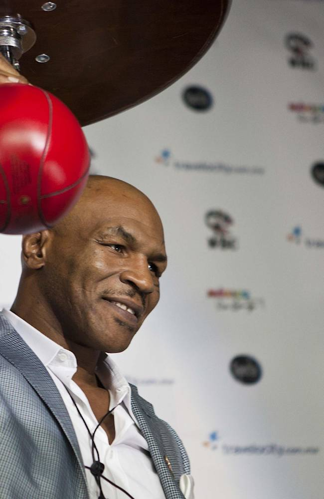 FILE- In this July 13, 2012, file photo, former heavyweight champion Mike Tyson poses for photographers during a news conference in Mexico City. Dr. Charles Butler, the head of USA Boxing, came out swinging Tuesday, Oct. 1, 2013, with an open letter to Tyson that accuses the former heavyweight champion with trying to poach fighters who might be candidates for the U.S. Olympic team in 2016