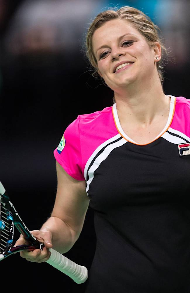 Belgium's Kim Clijsters reacts during an exhibition doubles tennis match against Belgium's Kirsten Flipkens and France's Henri Leconte at the Sportpaleis in Antwerp on Wednesday Dec. 11, 2013. Clijsters played with Belgium's Xavier Malisse