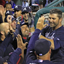 Atlanta Braves' Dan Uggla, right celebrates with his teammates after he hit a grand slam against the Philadelphia Phillies in the ninth inning of a baseball game Monday, April 14, 2014, in Philadelphia. Atlanta won 9-6 The Associated Press