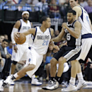 Dallas Mavericks guard Devin Harris (20) drives against San Antonio Spurs guard Cory Joseph (5) as Mavericks' Dirk Nowitzki (41) sets a pick during the first half an NBA basketball game Thursday, April 10, 2014, in Dallas The Associated Press