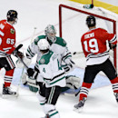 Chicago Blackhawks center Andrew Shaw (65) and center Jonathan Toews (19) watch Patrick Sharp's goal bounce around inside the net past Dallas Stars defenseman Brenden Dillon (4) and goalie Kari Lehtonen during the second period of an NHL hockey game Tuesd