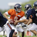 Chicago Bears quarterback Jimmy Clausen (8) looks to a pass during NFL football training camp at Olivet Nazarene University, Wednesday, July 30, 2014, in Bourbonnais, Ill The Associated Press