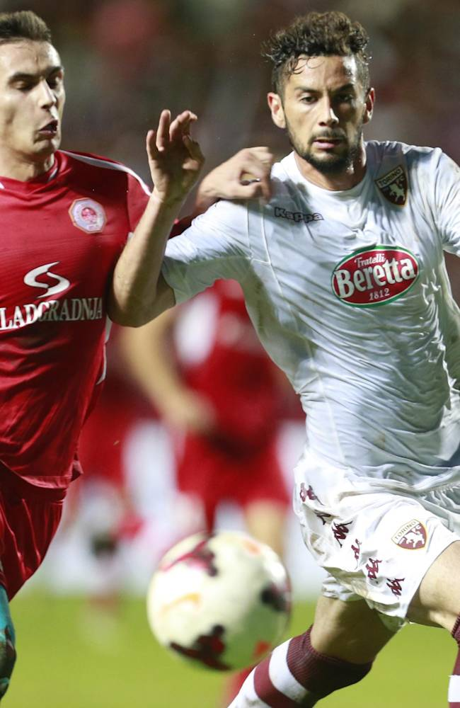Torino's Marcelo Larrondo, right, is challenged by Split's Dario Rugasevic during the Europa League play-off soccer match between Torino and Split, in Dugopolje, Croatia, Thursday, Aug. 21, 2014