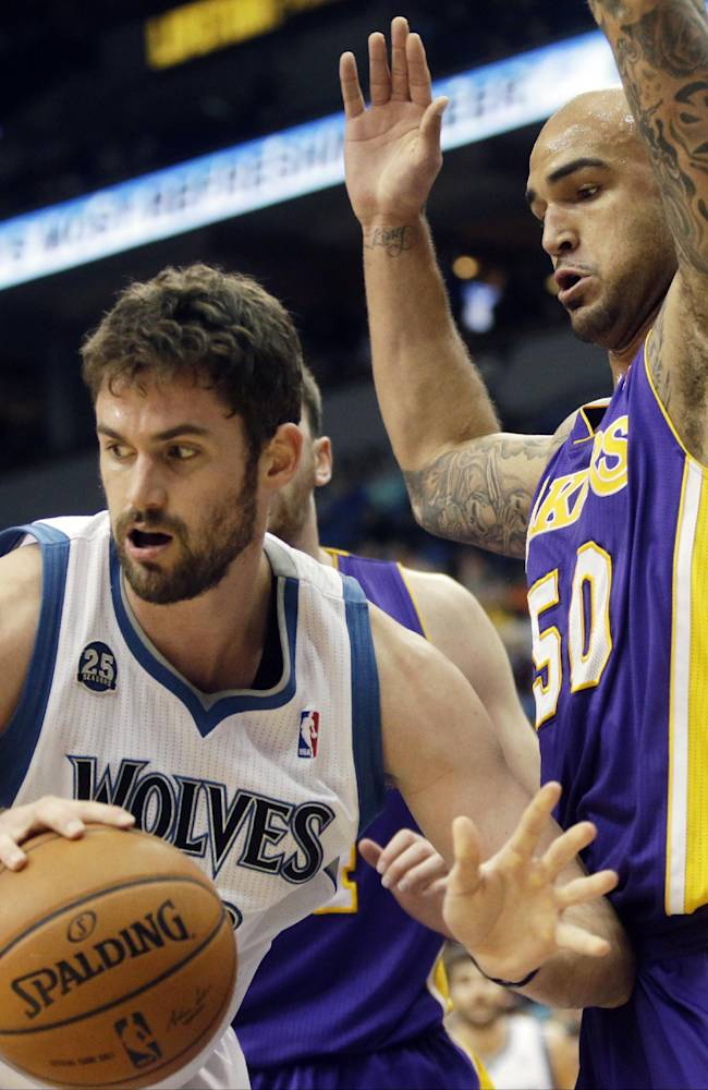 Minnesota Timberwolves' Kevin Love, left, looks for help as Los Angeles Lakers' Robert Sacre defends during the first quarter of an NBA basketball game, Tuesday, Feb. 4, 2014, in Minneapolis