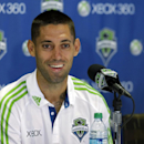 Clint Dempsey smiles as he talks to reporters after he was introduced as the newest player for the Seattle Sounders MLS soccer team, Monday, Aug. 5, 2013, in Seattle. Dempsey previously played for Tottenham Hotspur in the English Premier League. (AP Photo/Ted S. Warren)
