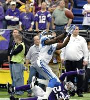 Detroit Lions wide receiver Calvin Johnson catches a pass over Minnesota Vikings cornerback Cedric Griffin (23) during overtime of an NFL football game Sunday, Sept. 25, 2011, in Minneapolis. The Lions won 26-23.