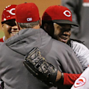 Cincinnati Reds starting pitcher Johnny Cueto, right, hugs manager Bryan Price after throwing a three-hit, 4-1 win over the Pittsburgh Pirates in a baseball game in Pittsburgh Tuesday, April 22, 2014 The Associated Press