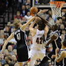 Brooklyn Nets' Andrei Kirilenko (47) and Kevin Garnett (2) battle for a rebound against Portland Trail Blazers' Robin Lopez (42) during the first half of an NBA basketball game in Portland, Ore., Wednesday, Feb. 26, 2014 The Associated Press