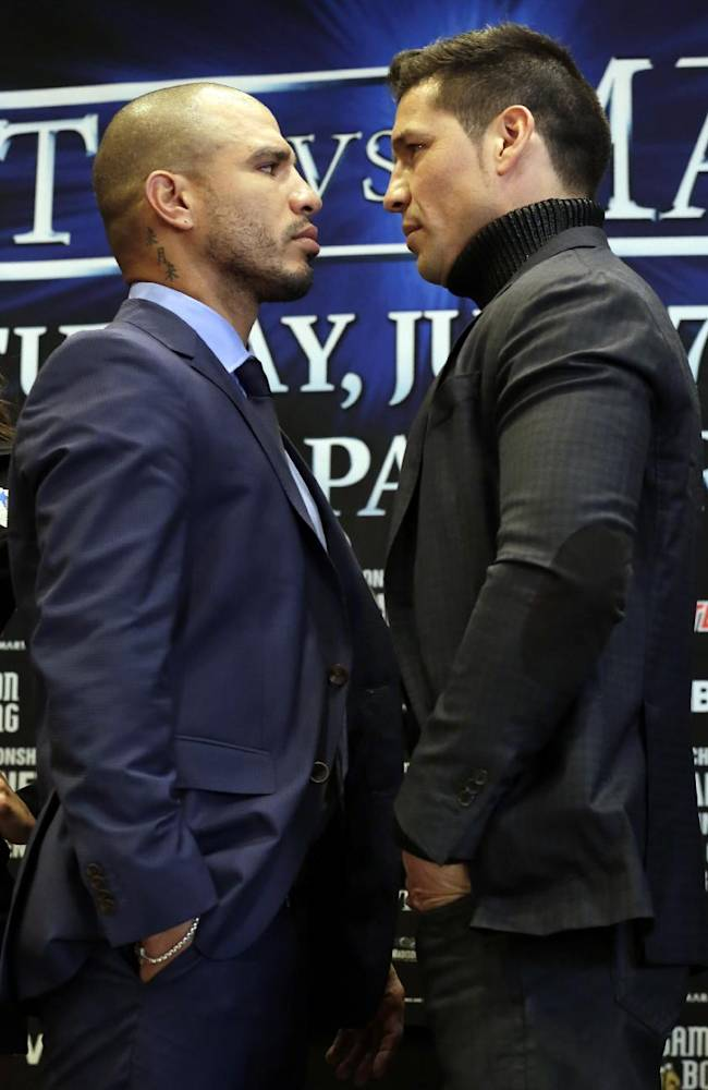 WBC middleweight champion Sergio Martinez, right, of Argentina, and challenger Miguel Cotto, of Puerto Rico, face off during a news conference in New York's Madison Square Garden, Tuesday, March 11, 2014, to promote their scheduled June 7, 2014, bout