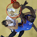 Oklahoma City Thunder power forward Serge Ibaka (9) goes to the basket against New Orleans Pelicans power forward Lou Amundson in the second half of an NBA basketball game in New Orleans, Friday, Dec. 6, 2013. The Thunder won 109-95 The Associated Press