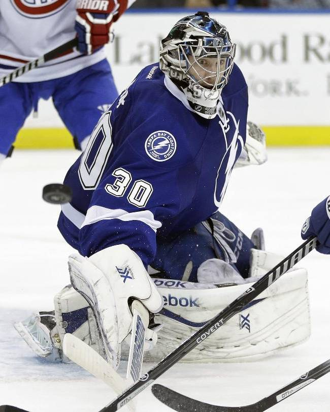 Tampa Bay Lightning goalie Ben Bishop makes a save on a shot by the Montreal Canadiens during the third period of an NHL hockey game Tuesday, April 1, 2014, in Tampa, Fla. The Lightning won 3-1