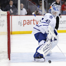 A puck shot by the New Jersey Devils goes wide of Toronto Maple Leafs goalie Jonathan Bernier's net during the second period of an NHL hockey game, Wednesday, Jan. 28, 2015, in Newark, N.J The Associated Press