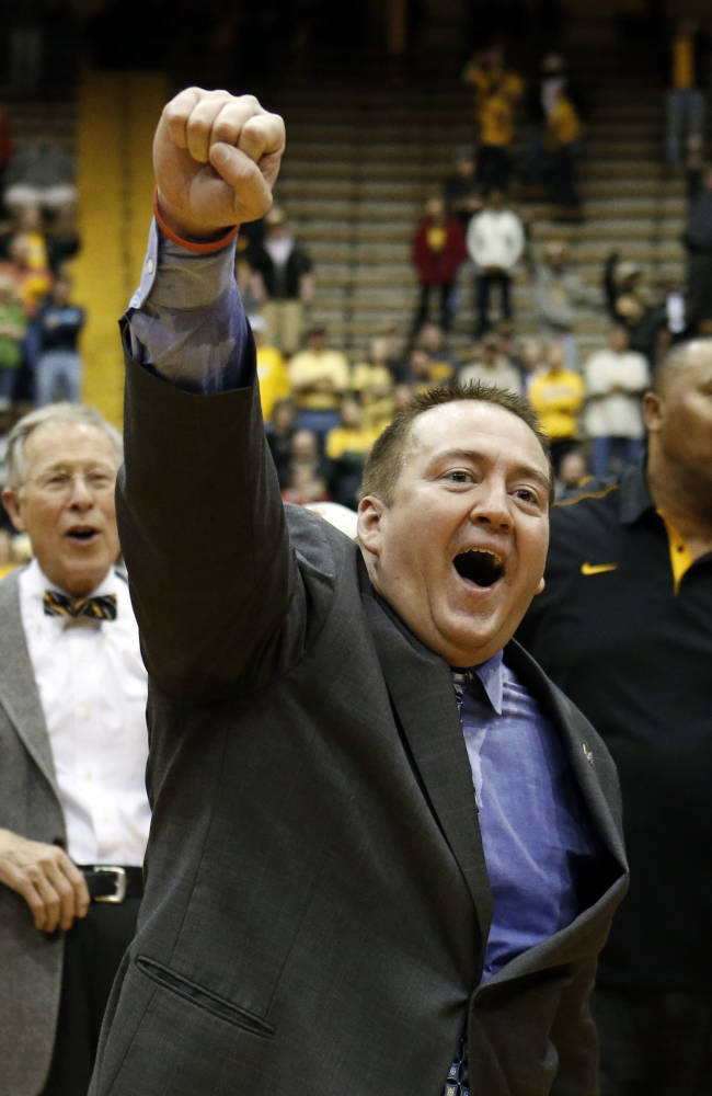 In this March 25, 2013 file photo, Southern Mississippi basketball coach Donnie Tyndall celebrates his team's 63-52 win over Louisiana Tech in their NIT college basketball game in Hattiesburg, Miss. Tennessee is counting on Tyndall to make the same successful transition from the mid-major ranks as the Volunteers' last two men's basketball coaches. Tennessee announced Tuesday morning, April 22, 2014, that Tyndall would be introduced as its new coach at a 2 p.m. news conference