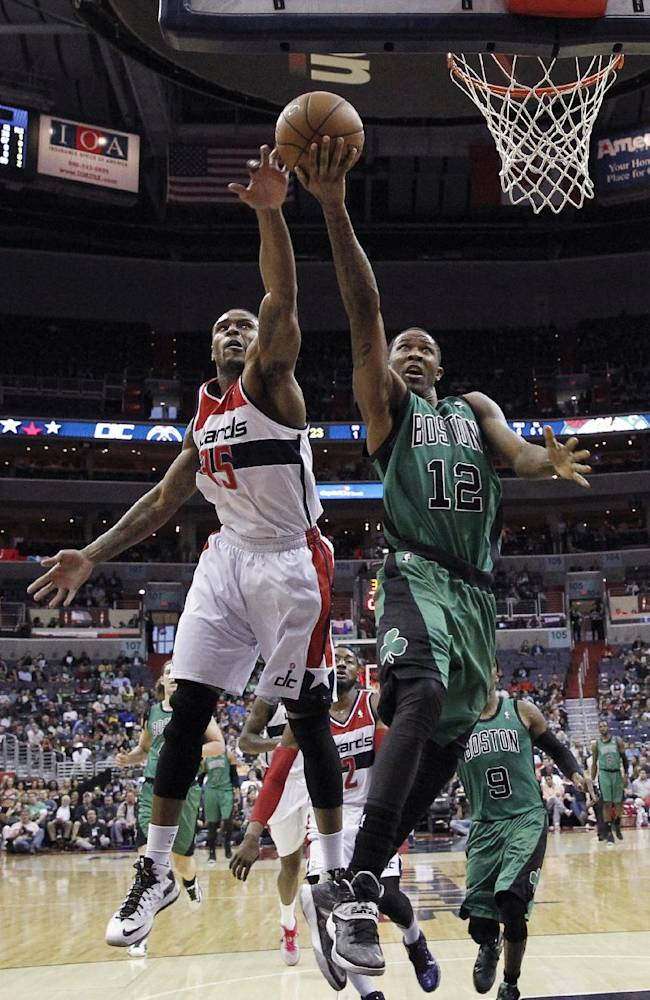 Washington Wizards forward Trevor Booker (35) blocks a shot by Boston Celtics forward Chris Johnson (12) during the first half of an NBA basketball game Wednesday, April 2, 2014 in Washington. The Wizards won 118-92, and clinched a playoff berth
