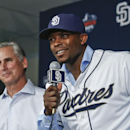 Recently acquired outfielder Justin Upton of the San Diego Padres is flanked by manager Bud Black at a news conference where the Padres introduced four of their new players Tuesday, Jan. 6, 2015, in San Diego The Associated Press