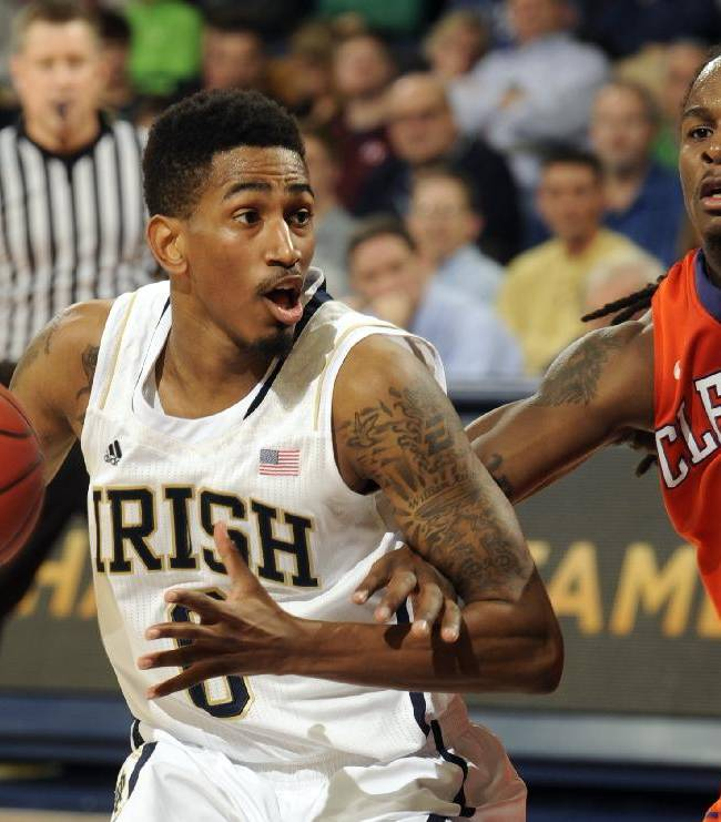 Notre Dame guard Eric Atkins, left, drives the lane as Clemson guard Rod Hall defends in first half of an NCAA college basketball game, Tuesday, Feb. 11, 2014, in South Bend, Ind