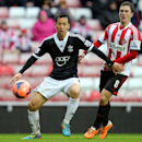Southampton's Yoshida Maya, left, vies for the bal with Sunderland's Craig Gardner, right, during their English FA Cup fifth round soccer match at the Stadium of Light, Sunderland, England, Saturday, Feb. 15, 2014