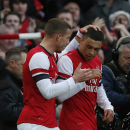 Arsenal's Alex Oxlade-Chamberlain, right, celebrates his goal against Liverpool with teammate Lukas Podolski during their English FA Cup fifth round soccer match at Emirates Stadium in London, Sunday, Feb. 16, 2014