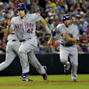 New York Mets' Omar Quintanilla, right, and Travis D'Arnaud score on a hit by teammate Eric Young Jr. during the fourth inning of a baseball game against the Arizona Diamondbacks on Tuesday, April 15, 2014, in Phoenix The Associated Press