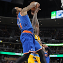 New York Knicks guard J.R. Smith, front, fouls Denver Nuggets forward J.J. Hickson on a rebound late in the fourth quarter of the Nuggets' 97-95 victory in an NBA basketball game in Denver on Friday, Nov. 29, 2013 The Associated Press