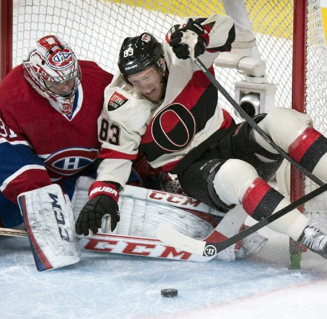 Ottawa Senators' Ales Hemsky charges into Montreal Canadiens goalie Carey Price, left, during the first period of an NHL hockey game Saturday, March 15, 2014, in Montreal