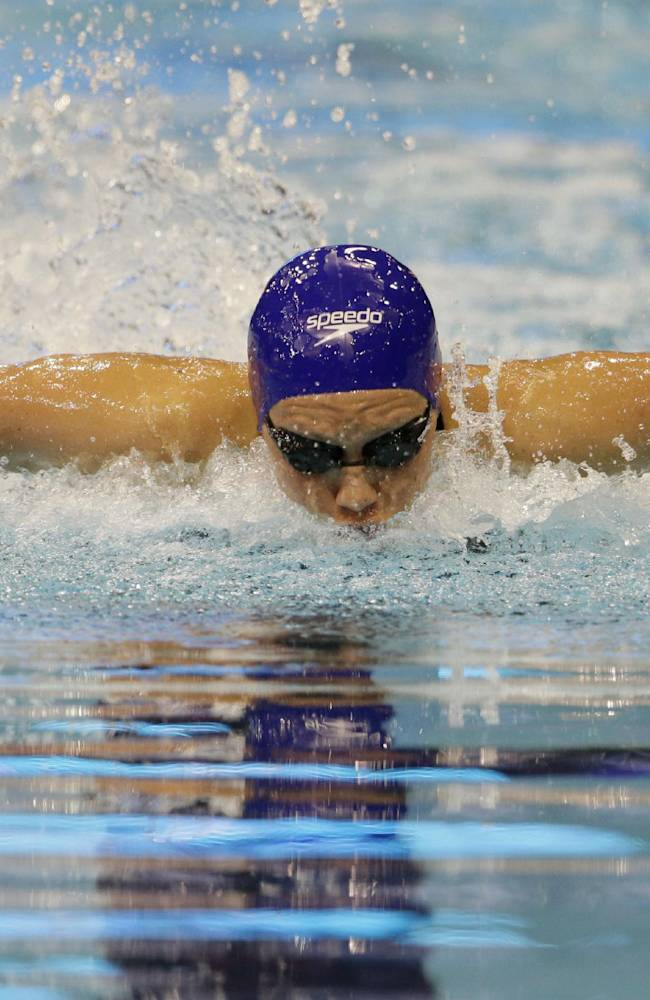 Britain's Jemma Lowe competes in a women's 100m butterfly first round heat at the LEN Swimming European Championships in Berlin, Germany, Thursday, Aug. 21, 2014