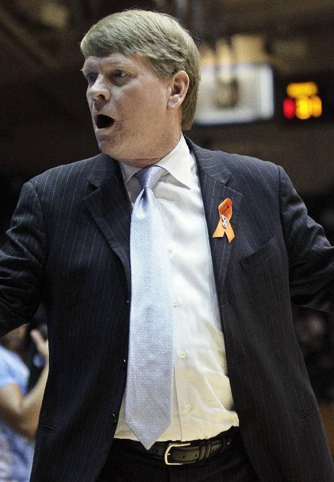 North Carolina interim head coach Andrew Calder reacts to an official's call during the first half of an NCAA college basketball game against Duke in Durham, N.C., Monday, Feb. 10, 2014. North Carolina won 89-78