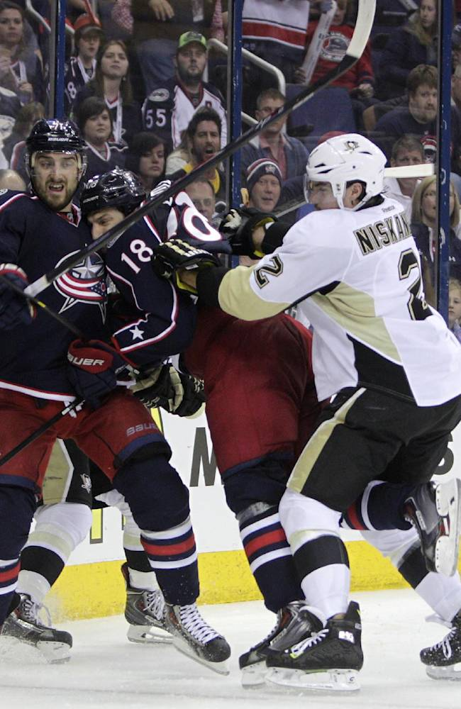 Pittsburgh Penguins' Matt Niskanen, right, cross checks Columbus Blue Jackets' RJ Umberger, center, into Nick Foligno during the second period of a first-round NHL playoff hockey game Monday, April 21, 2014, in Columbus, Ohio. Niskanen was issued a penalty for the hit