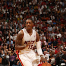 MIAMI, FL - NOVEMBER 15: Mario Chalmers #15 of the Miami Heat drives against the Dallas Mavericks on November 15, 2013 at American Airlines Arena in Miami, Florida. (Photo by Issac Baldizon/NBAE via Getty Images)