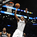 Orlando Magic' Arron Afflalo (4) watches Brooklyn Nets' Joe Johnson (7) drive the ball to the basket in the first half of an NBA basketball game Sunday, April 13, 2014, in New York The Associated Press