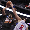 Phoenix Suns forward Markieff Morris (11) shoots over Los Angeles Clippers forward Hedo Turkoglu (8), of Turkey during the second half of an NBA basketball game Monday, March 10, 2014, in Los Angeles. Clippers won 112-105 The Associated Press