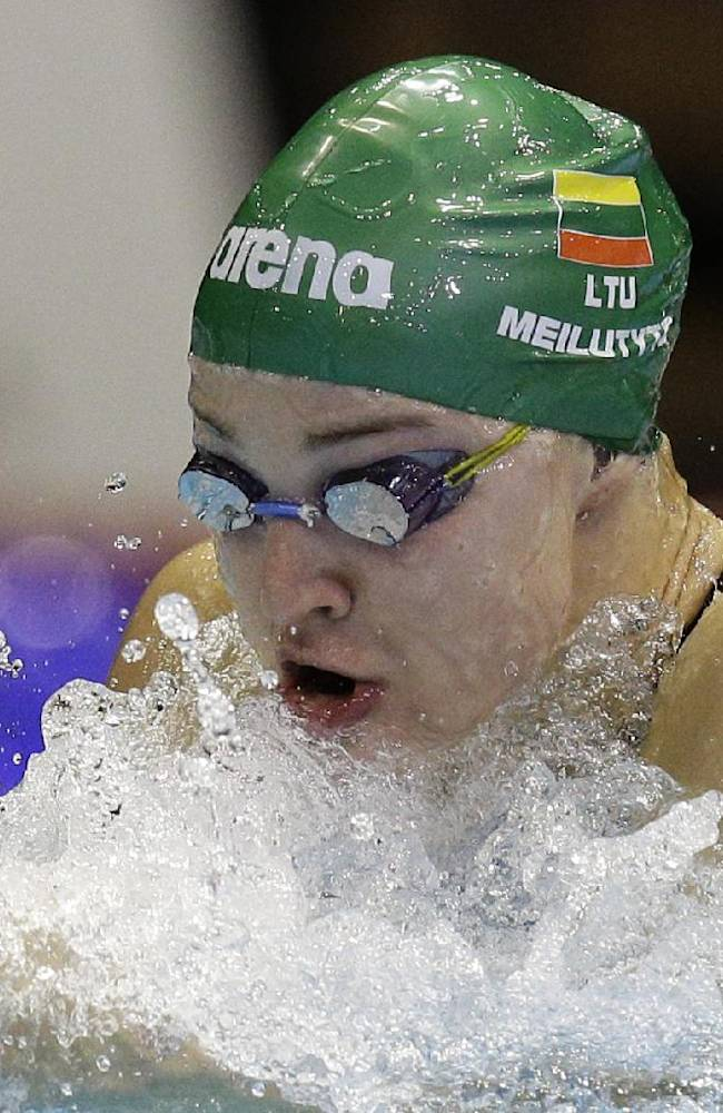 Lithuania's Ruta Meilutyte competes in a women's 50m breaststroke first round heat at the LEN Swimming European Championships in Berlin, Germany, Saturday, Aug. 23, 2014