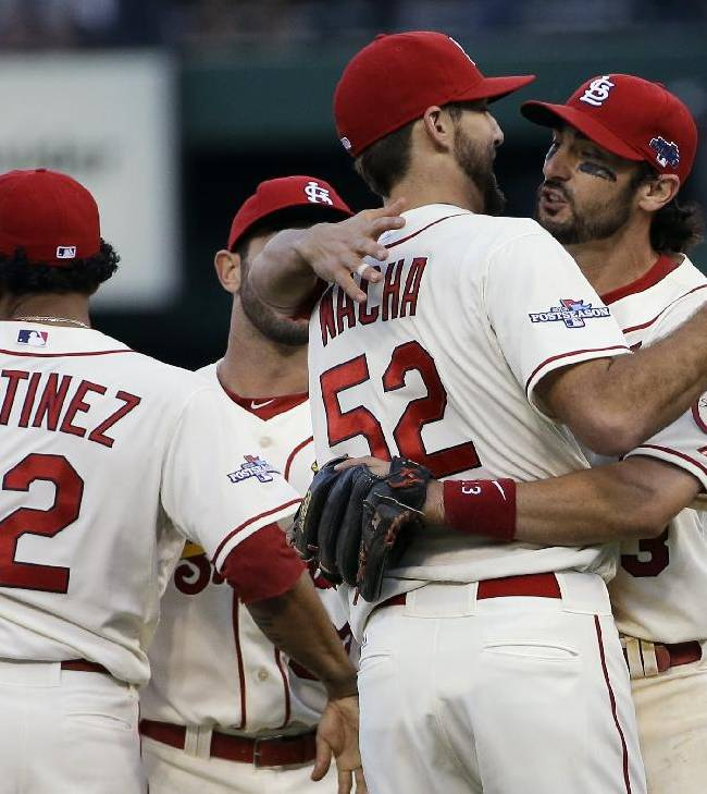 St. Louis Cardinals' Matt Carpenter hugs Michael Wacha (52) after Game 2 of the National League baseball championship series against the Los Angeles Dodgers Saturday, Oct. 12, 2013, in St. Louis. Cardinals won 1-0 to take a 2-0 lead in the series