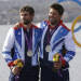 Great Britain's star class crew Iain Percy, right, and Andrew Simpson celebrate their silver medal at the London 2012 Summer Olympics, Sunday, Aug. 5, 2012, in Weymouth and Portland, England. (AP Photo/Bernat Armangue)