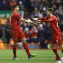 Liverpool's Steven Gerrard, left, is substituted for Liverpool's Adam Lallana during the English League Cup semi-final first leg soccer match between Liverpool and Chelsea at Anfield Stadium, Liverpool, England, Tuesday Jan. 20, 2015