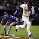 New York Mets pitcher Carlos Torres, left, fields a ball hit by Atlanta Braves' Jason Heyward as he looks to throw to first base for the out in the sixth inning of a baseball game, Thursday, April 10, 2014, in Atlanta The Associated Press