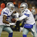 Dallas Cowboys quarterback Tony Romo (9) hands off to running back DeMarco Murray (29) during the first half of an NFL football game against the Chicago Bears, Monday, Dec. 9, 2013, in Chicago The Associated Press