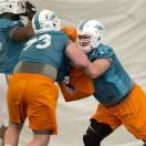 Miami Dolphins players Patrick Ward (73) and Tyson Clabo (77) run drills during the NFL football training camp in Davie, Fla. Tuesday, May 21, 2013. (AP Photo/J Pat Carter)