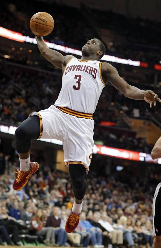 Cleveland Cavaliers' Dion Waiters (3) goes up for a dunk against the San Antonio Spurs during the second quarter of an NBA basketball game Tuesday, March 4, 2014, in Cleveland
