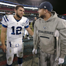 Indianapolis Colts quarterback Andrew Luck (12) talks with injured Tennessee Titans quarterback Jake Locker after an NFL football game Thursday, Nov. 14, 2013, in Nashville, Tenn. The Colts won 30-27 The Associated Press