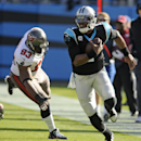 Carolina Panthers' Cam Newton, right, runs past Tampa Bay Buccaneers' Gerald McCoy, left, in the first half of an NFL football game in Charlotte, N.C., Sunday, Dec. 1, 2013 The Associated Press
