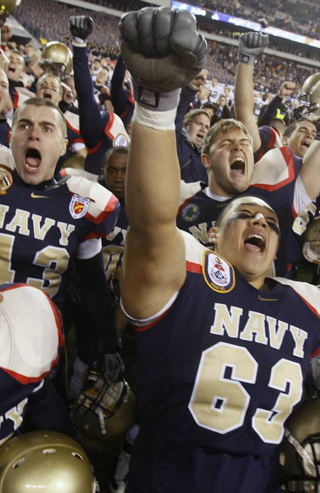 In this Dec. 12, 2009 file photo, Navy's David Hong (63) and teammates celebrate after their 17-3 win over Army in an NCAA college football game in Philadelphia. The Army-Navy series should be retitled because Navy always comes out on top. The Mids' winning streak in the series stretches back more than a decade and there's little reason to think they won't romp again Saturday, Dec. 14, 2013 in Philadelphia