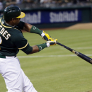 Oakland Athletics' Yoenis Cespedes hits a two-run home run against the Houston Astros during the fourth inning of a baseball game on Wednesday, July 23, 2014, in Oakland, Calif. (AP Photo)