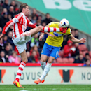 Stoke City's Peter Crouch, left, and Newcastle United's Mike Williamson battle for the ball during their English Premier League soccer match at the Britannia Stadium, Stoke On Trent, Saturday, April 12, 2014