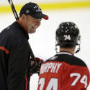 New Jersey Devils head coach Peter DeBoer, left, talks to Darcy Murphy during the team's NHL hockey rookies camp, Tuesday, July 15, 2014, in Newark, N.J. (AP Photo/Julio Cortez)
