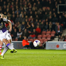 Liverpool's Steven Gerrard, left, scores a goal from a penalty shot, during their English Premier League match against Southampton, at St Mary's, Southampton, England, Saturday March 1, 2014