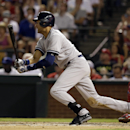 New York Yankees' Derek Jeter follows through on a single to right off a pitch from Texas Rangers' Yu Darvish as Chris Gimenez, right, watches in the seventh inning of a baseball game, Monday, July 28, 2014, in Arlington, Texas. (AP Photo/Tony Gutierrez)
