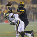 UCLA defensive back Ishmael Adams breaks up a pass intended for Arizona State running back D.J. Foster during the second half of an NCAA college football game, Thursday, Sept. 25, 2014, in Tempe, Ariz. The Associated Press
