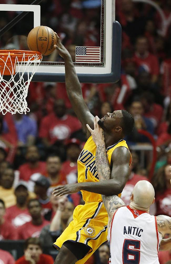 Indiana Pacers guard Lance Stephenson (1) is fouled by Atlanta Hawks center Pero Antic (6) while trying to score in the second half of Game 6 of a first-round NBA basketball playoff series in Atlanta, Thursday, May 1, 2014. Indiana won 95-88