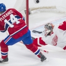 Detroit Red Wings goaltender Jonas Gustavsson makes a save against Montreal Canadiens' Tomas Plekanec during the first period of an NHL hockey game in Montreal, Saturday, April 5, 2014 The Associated Press